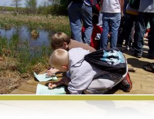 5th grade students recording observations at Cedar Bog Lake.