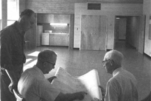 three men in lab in 1957